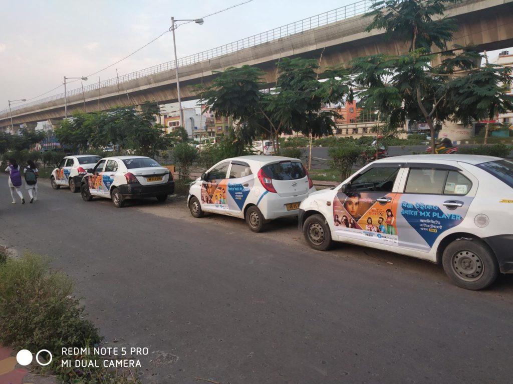 Car Branding campaign in Kolkata. OOH Cab Branding,Car Branding,Taxi Advertisement,Ola Cab Branding,Ola Uber Car Advertising