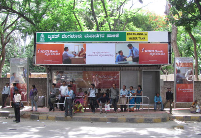 bus branding in bangalore, bus shelter advertising in bengaluru, bus stop ads.
